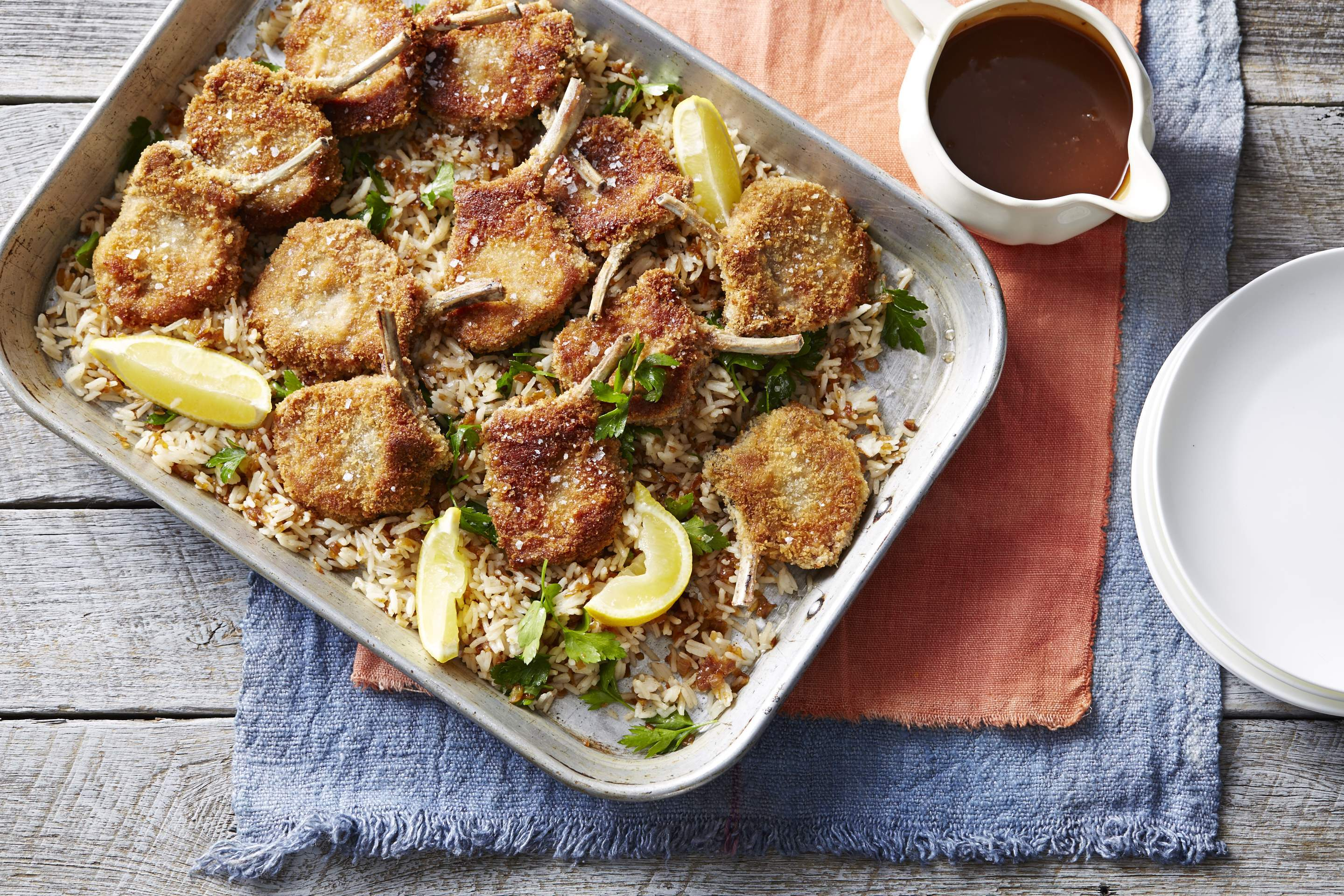 Crumbed lamb cutlets with sweet onion rice and gravy