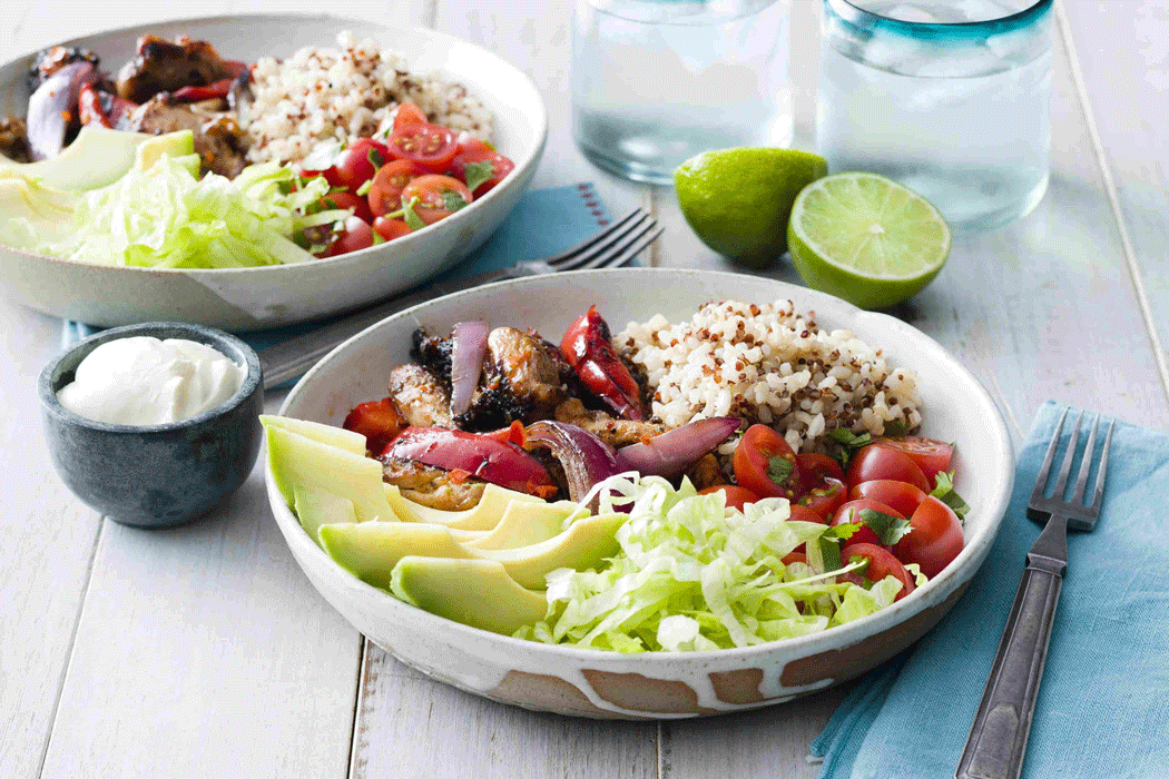 Chicken fajita bowl with vegetables, rice and quinoa