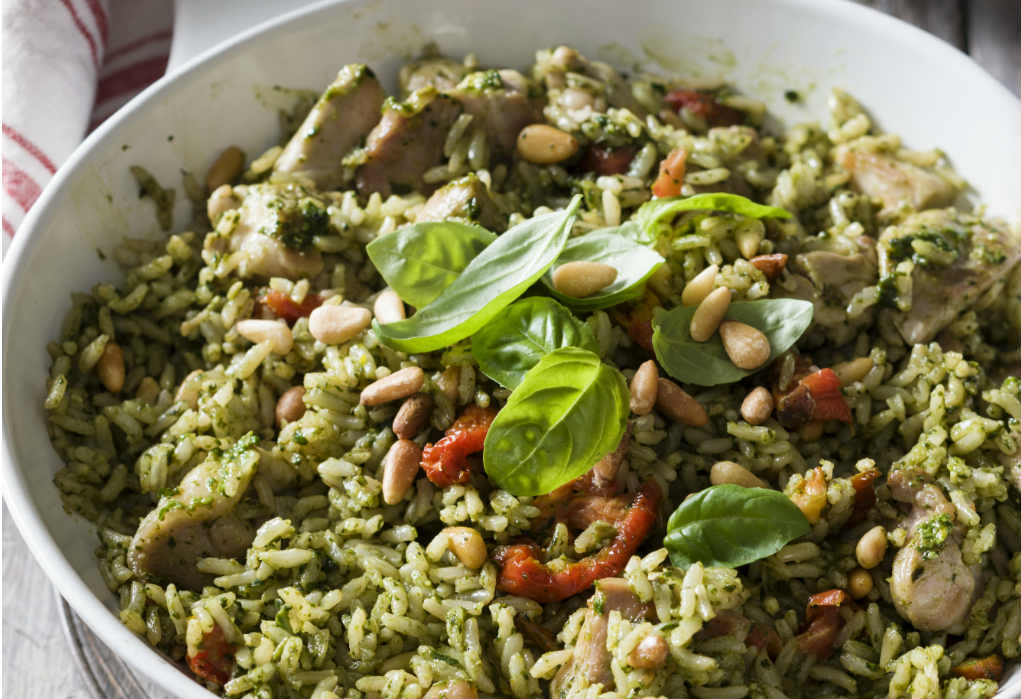 Chicken pesto rice topped with basil
