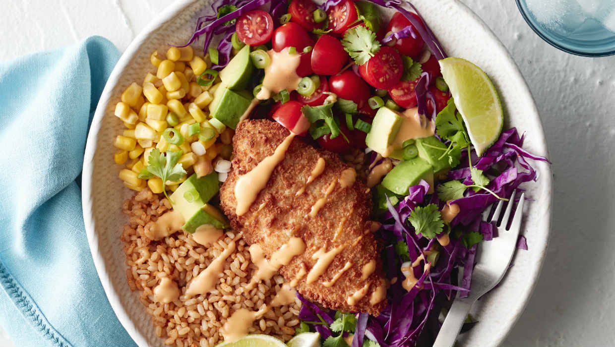 Fish taco bowl with vegetables and rice