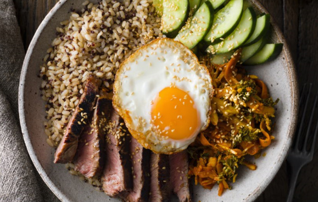 Korean beef steak with egg on brown rice