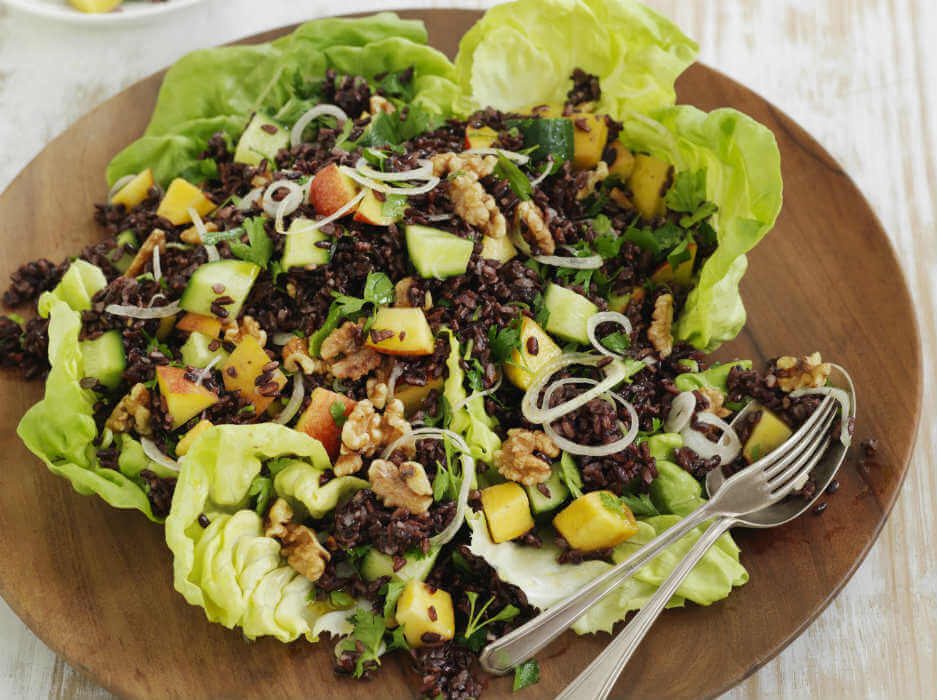Walnut, cucumber and peach salad in lettuce