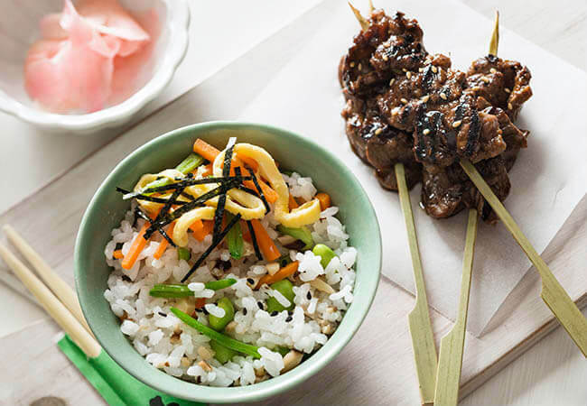 Sushi salad rice with japanese beef skewers